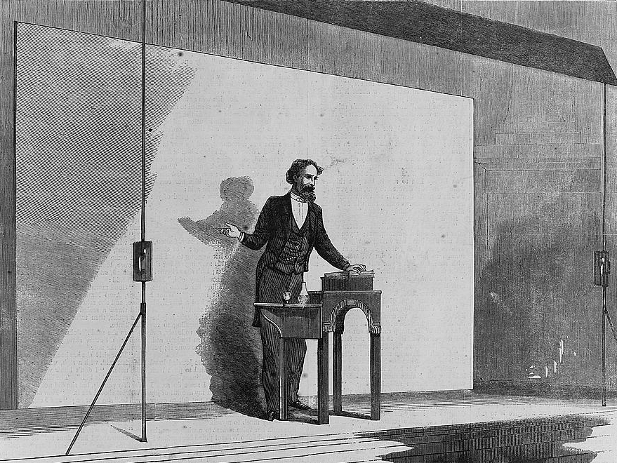 A wood engraving from a sketch of Charles Dickens doing a public reading of his book in 1867