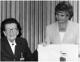 Norma Skemp with Angela Rippon at an awards presentation.